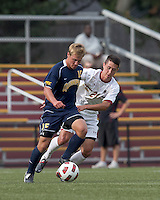 Quinnipiac University forward Philip Suprise (15) dribbles as Boston College midfielder/defender Colin Murphy (21) defends. Boston College defeated Quinnipiac, 5-0, at Newton Soccer Field, September 1, 2011.