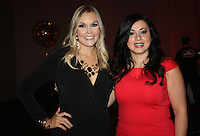 NWA Democrat-Gazette/CARIN SCHOPPMEYER Kaley Schwab (left) and Silvia Azrai-Kawas, Paint the Town Red chairwoman, welcome guests to the American Heart Assoication fundraiser.