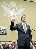FBI Director James Comey is sworn-in to testify before the United States House Committee on Oversight and Government Reform following his announcement on Tuesday that he would recommend not to prosecute former US Secretary of State Hillary Clinton for maintaining a private server on Capitol Hill in Washington, DC on Thursday, July 7, 2016.<br /> Credit: Ron Sachs / CNP<br /> (RESTRICTION: NO New York or New Jersey Newspapers or newspapers within a 75 mile radius of New York City)