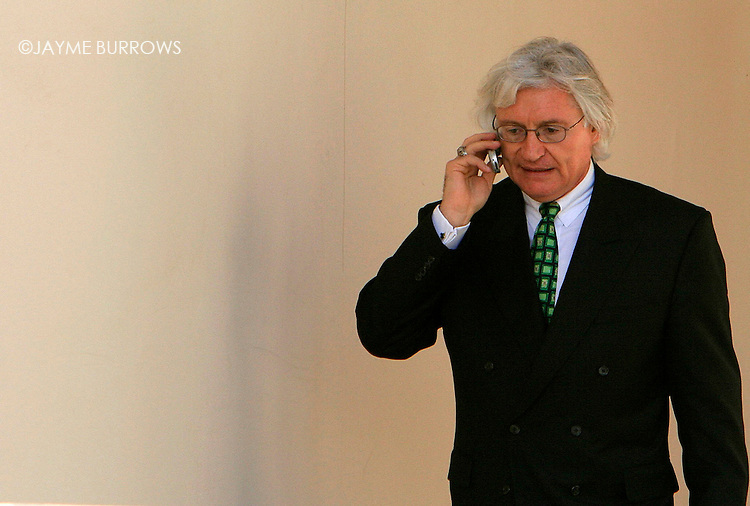Michael Jackson's defense attorney Thomas Mesereau makes a phone call during a break in the child molestation trial in Santa Maria, California on March 28, 2005