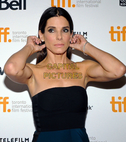Sandra Bullock<br /> &quot;Gravity&quot; Premiere - 2013 Toronto International Film Festival held at Princess of Wales Theatre<br /> September 8th, 2013<br /> TIFF half length dress hands arms armpit black strapless   <br /> CAP/ADM/BPC<br /> &copy;Brent Perniac/AdMedia/Capital Pictures