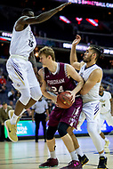 Washington, DC - MAR 7, 2018: Fordham Rams forward Prokop Slanina (24) is defended against George Washington Colonials Bo Zeigler (35) and George Arnaldo Toro (11) in game between G.W. and Fordham during first round action of the Atlantic 10 Basketball Tournament at the Capital One Arena in Washington, DC. (Photo by Phil Peters/Media Images International)