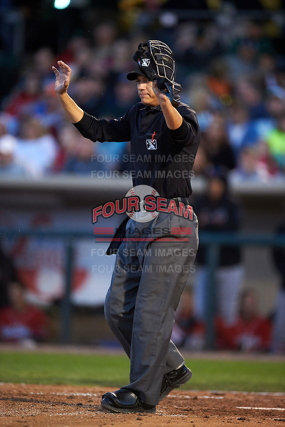 Umpire Tyler Olson calls time during a game between the Great Lakes Loons and Dayton Dragons on May 21, 2015 at Fifth Third Field in Dayton, Ohio.  Great Lakes defeated Dayton 4-3.  (Mike Janes/Four Seam Images)