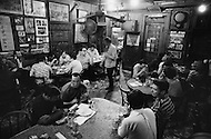 August 1970, Manhattan, New York City, New York State, USA --- Men drinking ale at McSorley's Old Ale House in Manhattan in 1970. McSorley's was New York City's oldest bar and it refused female patrons before 1970. --- Image by © JP Laffont