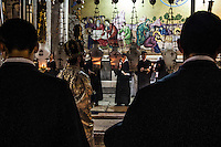 Armenian Orthodox Priests celebrating in front of the Stone of Anointing,  also known as the Stone of Unction. Jerusalem