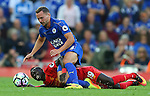Sadio Mane of Liverpool tussle with Daniel Drinkwater of Leicester City during the Premier League match at Anfield Stadium, Liverpool. Picture date: September 10th, 2016. Pic Simon Bellis/Sportimage