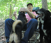 NWA Democrat-Gazette/FLIP PUTTHOFF <br /> Mills takes a break with Sparky (left) and Haile while hiking May 5, 2016 at Hobbs State Park-Conservation Area.