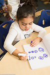 Education Preschool 3-4 year olds girl writing letters on drawing, using marker
