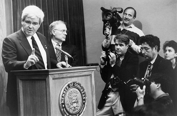 "During a press conference for the, Speaker of the House Rep. Newton Leroy ""Newt"" Gingrich, R-Ga., and Rep. Thomas W. ""Tom"" Ewing, R-Ill., speak. November 8, 1995 (Photo by Maureen Keating/CQ Roll Call)"