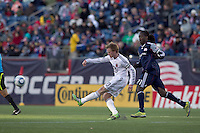 DC United midfielder Dax McCarty (10) passes the ball as New England Revolution midfielder Shalrie Joseph (21) closes. In a Major League Soccer (MLS) match, the New England Revolution defeated DC United, 2-1, at Gillette Stadium on March 26, 2011.