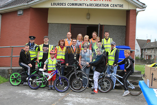 Mayor Kevin Callan with Volunteers from Southside Youth, DYD, St.Josephs CBS, Louth County Council, members of the Gardai and participants at the Bike Week Safety Cycle..(Photo credit should read Jenny Matthews www.newsfile.ie)....This Picture has been sent you under the conditions enclosed by:.Newsfile Ltd..The Studio,.Millmount Abbey,.Drogheda,.Co Meath..Ireland..Tel: +353(0)41-9871240.Fax: +353(0)41-9871260.GSM: +353(0)86-2500958.email: pictures@newsfile.ie.www.newsfile.ie.