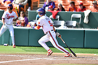 Clemson Tigers right fielder Steven Duggar (9) swings at a pitch during a game against the Notre Dame Fighting Irish during game one of a double headers at Doug Kingsmore Stadium March 14, 2015 in Clemson, South Carolina. The Tigers defeated the Fighting Irish 6-1. (Tony Farlow/Four Seam Images)