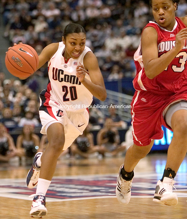 HARTFORD, CT. 05 March 2007-030507SV08--#20 Renee Montgomery of UConn drives up court as #23 Helen Johnson of Louisville follows during Big East semifinal tournament action at the Hartford Civic Center in Hartford Monday.<br /> Steven Valenti Republican-American