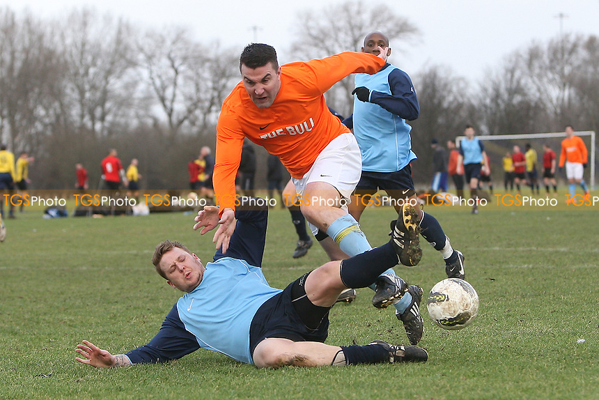 Hatch Lane (blue) vs Albert Royals (orange) - East London Sunday League Football at South Marsh, Hackney Marshes, London - 22/01/12 - MANDATORY CREDIT: Gavin Ellis/TGSPHOTO - Self billing applies where appropriate - 0845 094 6026 - contact@tgsphoto.co.uk - NO UNPAID USE.