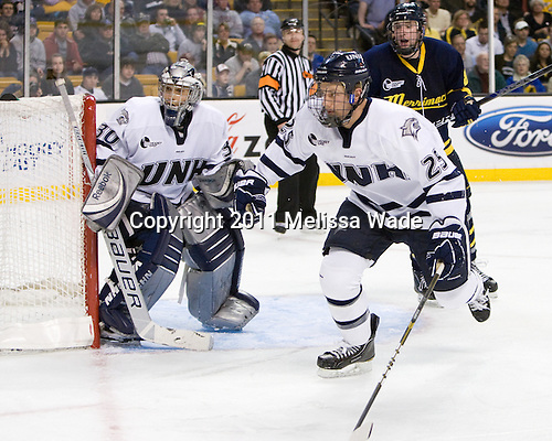Matt DiGirolamo (UNH - 30), Mike Beck (UNH - 25), John Heffernan (Merrimack - 8) - The Merrimack College Warriors defeated the University of New Hampshire Wildcats 4-1 in their Hockey East Semi-Final on Friday, March 18, 2011, at TD Garden in Boston, Massachusetts.