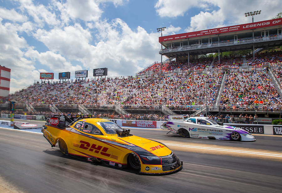 Jun 21, 2015; Bristol, TN, USA; NHRA funny car driver Del Worsham (near lane) races alongside Tony Pedregon during the Thunder Valley Nationals at Bristol Dragway. Mandatory Credit: Mark J. Rebilas-
