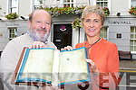 Kevin Malley from Killarney Town Council presents a copy of the Annals of Inisfallen to Kathleen Rice who will put it on display in Killarney library on friday night between 6-8pm for Culture night