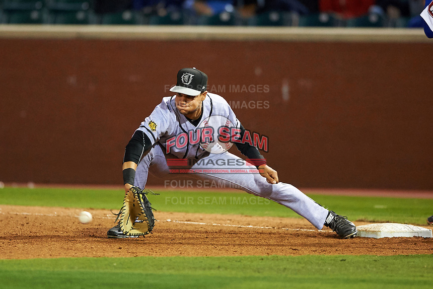 Jacksonville Suns first baseman Viosergy Rosa (44) stretches for a throw during a game against the Chattanooga Lookouts on April 30, 2015 at AT&T Field in Chattanooga, Tennessee.  Jacksonville defeated Chattanooga 6-4.  (Mike Janes/Four Seam Images)