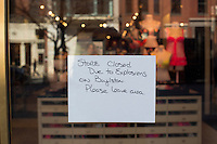 "A sign on a Newbury Street Victoria's Secret store near the site of the bombings in Boston, Mass., states that the store is closed due to the bombings on April 16, 2013, the day after bombings at the Boston Marathon.  The sign reads ""Store closed due to explosions on Boylston. Please leave area."""