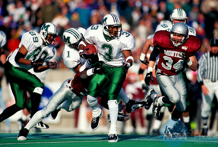 21 DEC 1996:  Running back Erik Thomas (3) of  Marshall University rushes against Montana during the Division I-AA Football Championship held at Marshall University Stadium in Huntington, WV.  Marshall defeated Montana 49-29 for the national title.  David Gonzales/NCAA Photos