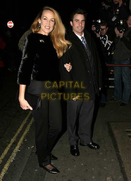 "JERRY HALL & GUEST.""Whose LIfe is it Anyway?"" VIP Opening Night, Comedy Theatre, London, January 26th 2005..full length black fur coat jacket brooch broach.Ref: AH.www.capitalpictures.com.sales@capitalpictures.com.©Capital Pictures."