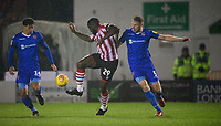 Lincoln City's John Akinde vies for possession with Morecambe's Josef Yarney, left, and Morecambe's Steven Old<br /> <br /> Photographer Chris Vaughan/CameraSport<br /> <br /> The EFL Sky Bet League Two - Saturday 15th December 2018 - Lincoln City v Morecambe - Sincil Bank - Lincoln<br /> <br /> World Copyright © 2018 CameraSport. All rights reserved. 43 Linden Ave. Countesthorpe. Leicester. England. LE8 5PG - Tel: +44 (0) 116 277 4147 - admin@camerasport.com - www.camerasport.com