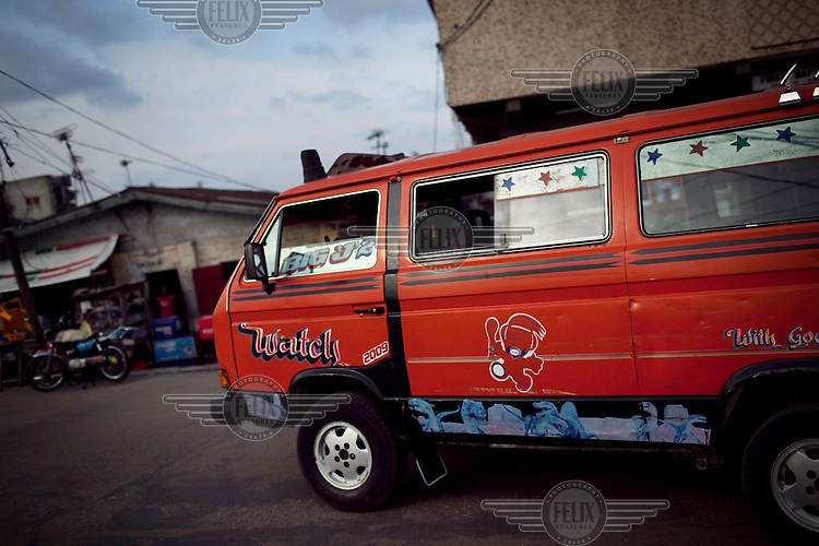 A privately owned minibus looks for passengers in Ajegunle. Ajegunle is Nigeria's biggest slum and a melting pot of the nation's (and the continent's) ethnic groups.