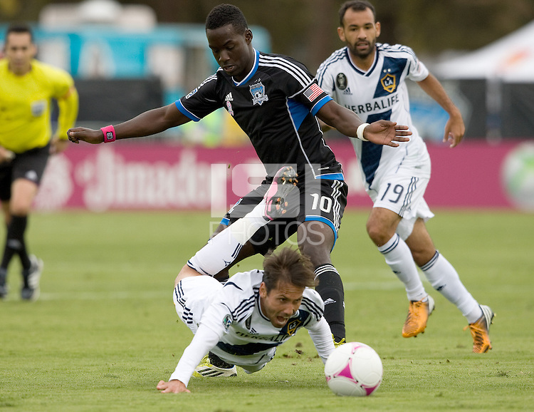 Simon Dawkins of Earthquakes fights for the ball against Marcelo Sarvas of Galaxy during the game at Buck Shaw Stadium in Santa Clara, California on October 21st, 2012.  San Jose Earthquakes and Los Angeles Galaxy tied at 2-2.