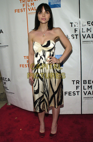 "CHRISTINA RICCI .6th Annual Tribeca Film Festival - ""We Are Together (Thina Simunye)"", An HBO Documentary Film, New York City, New York, USA..April 26th, 2007.full length black white cream satin pattern strapless dress hand on hip .CAP/ADM/BL.©Bill Lyons/AdMedia/Capital Pictures"