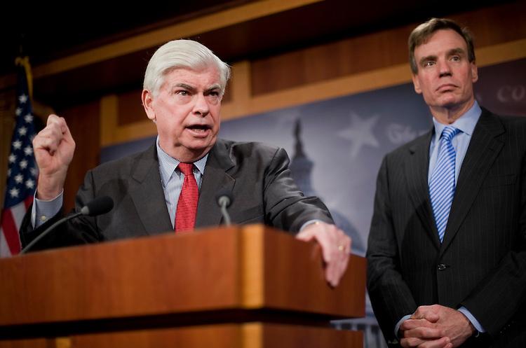 Senate Banking Committee Chairman Chris Dodd, D-Conn., left, and Sen. Mark Warner, D-Va., conduct a news conference on legislation that will reform financial institutions, April 19, 2010.