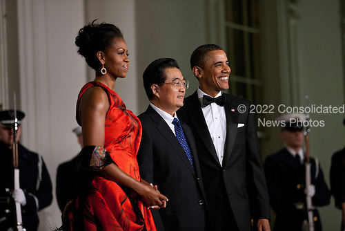 United States President Barack Obama and First Lady Michelle Obama welcome President Hu Jintao of China at the North Portico of the White House for the State Dinner, Wednesday, January 19, 2011. .Mandatory Credit: Lawrence Jackson - White House via CNP