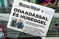 UNGARN, 08.05.2018, Budapest. Zur erneuten Amtseinfuehrung von MP Viktor Orb&aacute;n macht das regierungsnahe Blatt &quot;Magyar H&iacute;rlap&quot; mit der propagandistischen Schlagzeile auf: &quot;MIT HINGABE UND TREUE wird Viktor Orb&aacute;n Ungarn dienen.&quot; | On the occasion of the refreshed inauguration of PM Viktor Orban the pro-government newspaper &quot;Magyar Hirlap&quot; carries the propagandistic headline: &quot;WITH DEVOTION AND FAITHFULNESS is Viktor Orban going to serve Hungary.&quot;<br /> &copy; Martin Fejer/estost.net