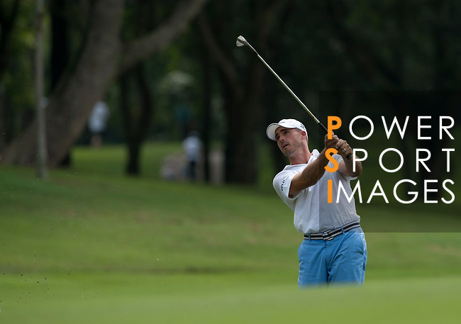 Jonathan Byrd in action during Round 1 of the CIMB Asia Pacific Classic 2011.  Photo © Andy Jones / PSI for Carbon Worldwide