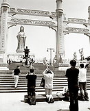 CHINA, Putou Shan, people pray on the steps of the Quanyin Temple at Putou Shan island
