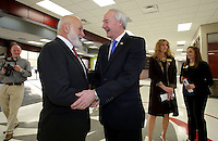 NWA Democrat-Gazette/DAVID GOTTSCHALK   John Tyson (left), chairman of the board for Tyson Foods, and Governor Asa Hutchinson speak Thursday, February 9, 2017, before a dedication ceremony for Springdale's new Don Tyson School of Innovation campus. The school is named after Donald Tyson former chairman and chief executive officer of Tyson Foods. Half of the campus opened in August, with construction wrapping up on the other half in time for this semester.