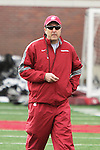 Mike Leach, Washington State head football coach, keeps an eye on the quarterbacks during a Cougar spring practice at Rogers Field on the WSU campus in Pullman, Washington, on March 24, 2012.