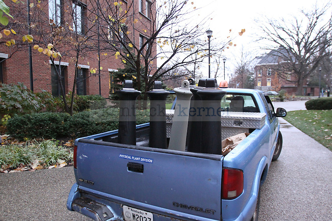 UK physical plant workers drive around campus picking up smoker' s posts on Wednesday evening before the tobacco ban goes into effect on Thursday Nov. 19th. Photo by Scott Hannigan | Staff