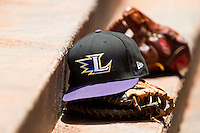 A Louisville Bats cap sits on a glove in the visitors dugout during the International League game against the Charlotte Knights at Knights Stadium on July 17, 2011 in Fort Mill, South Carolina.  The Knights defeated the Bats 7-6.   (Brian Westerholt / Four Seam Images)