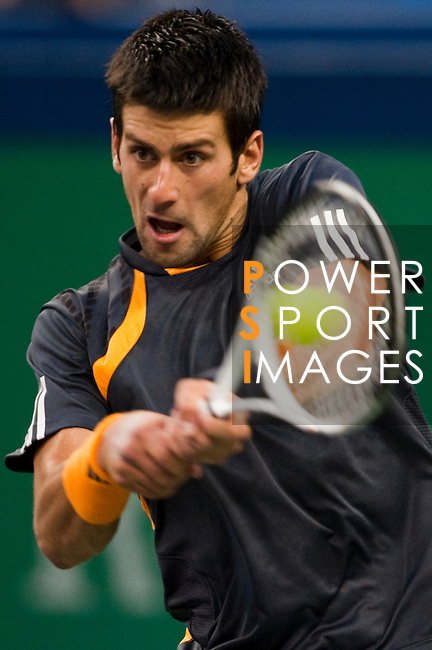 SHANGHAI, CHINA - OCTOBER 17:  Novak Djokovic of Serbia returns a shot to Nikolay Davydenko of Russia on their semi final match during day seven of 2009 Shanghai ATP Masters 1000 at Qi Zhong Tennis Centre on October 17, 2009 in Shanghai, China. Photo by Victor Fraile / The Power of Sport Images