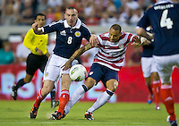 May 26, 2012:   USA Men's National Team m Jermaine Jones (13) fights for the ball against Scotland Scott Brown (8) during action between the USA and Scotland at EverBank Field in Jacksonville, Florida.............