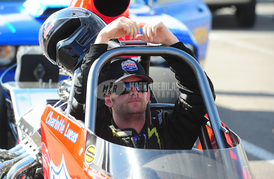 Mar. 12, 2012; Gainesville, FL, USA; NHRA super comp driver Brad Plourd during the Gatornationals at Auto Plus Raceway at Gainesville. The race is being completed on Monday after rain on Sunday. Mandatory Credit: Mark J. Rebilas-