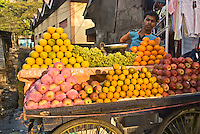 Port Blair, Andaman Islands. Indian boy selling fruits at the local market
