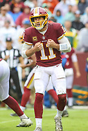 Landover, MD - September 23, 2018: Washington Redskins quarterback Alex Smith (11) changes the play during the  game between Green Bay Packers and Washington Redskins at FedEx Field in Landover, MD.   (Photo by Elliott Brown/Media Images International)