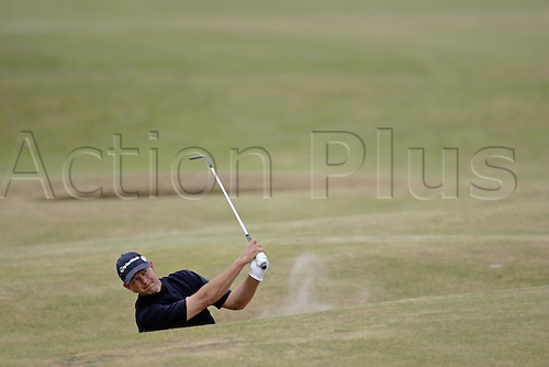 14 July 2005: South African golfer Retief Goosen (RSA) plays out of a fairway bunker on the 13th during the first round. Goosen shot a 4 under par 68 in The Open Championship, The Old Course at St Andrews, Scotland. Photo: Glyn Kirk/Actionplus....050714 golf major british sand