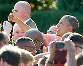 United States President Barack Obama flashes a thumbs-up to a well wisher as he works a rope line following his making remarks as he and first lady Michelle Obama during a Fourth of July barbecue hosted by he and first lady Michelle Obama for military heroes and their families on the South Lawn of the White House in Washington, D.C. on Thursday, July 4, 2013.<br /> Credit: Ron Sachs / Pool via CNP