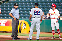 First Base Umpire Greg Stanzak argues a call with Manager Mike Micucci (22) of the Arkansas Travelers during a game against the Springfield Cardinals at Hammons Field on June 12, 2012 in Springfield, Missouri. (David Welker/Four Seam Images)