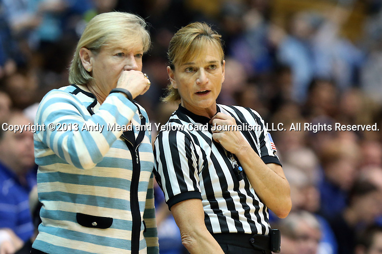 03 March 2013: UNC head coach Sylvia Hatchell (left) with referee Dee Kantner (right). The Duke University Blue Devils played the University of North Carolina Tar Heels at Cameron Indoor Stadium in Durham, North Carolina in a 2012-2013 NCAA Division I and Atlantic Coast Conference women's college basketball game. Duke won the game 65-58.