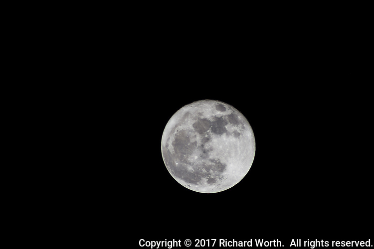 Full moon, the full cold moon, against a black sky.  The lone 'super moon' of 2017 is also known as the Long Nights Moon by some Native American tribes, according to the Farmer's Almanac.