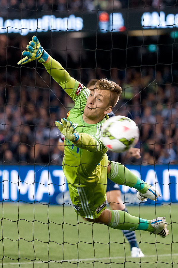 Lawrence Thomas of the Victory dives to make a save in the semi final match between Melbourne Victory and Melbourne City in the Australian Hyundai A-League 2015 season at Etihad Stadium, Melbourne, Australia.<br /> This photo is not for sale. Contact zumapress.com for editorial licensing.