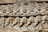 Close up of the sculpture of the twelve gods of the underworld from the 13th century BC Hittite religious rock carvings of Yazılıkaya Hittite rock sanctuary, chamber B,  Hattusa, Bogazale, Turkey.